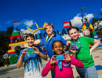 Kids holding their annual passes